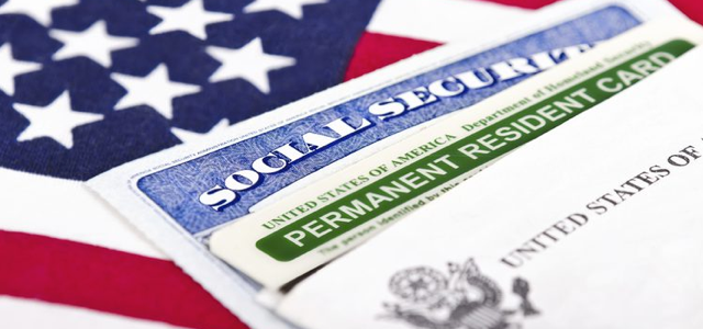 EB-5 Social Security and Green Card on Flag