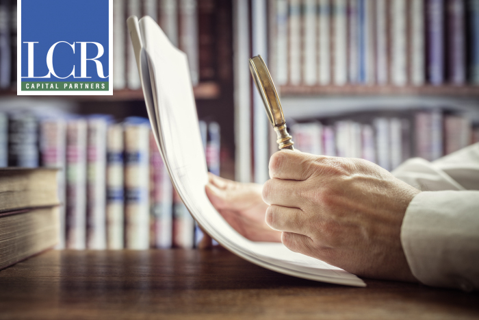 lawyer with magnifying glass and lcr logo